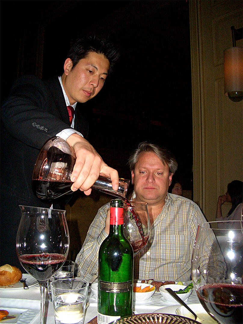 Sommelier serving wine